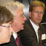Panel members at the hearing